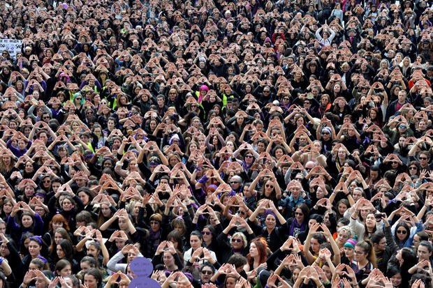 Protesters form triangles with their hands during a demonstration for women's rights in Bilbao