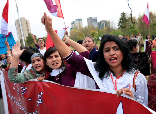 Demonstrators hold banners and shout slogans during a rally to mark International Women's Day in Islamabad