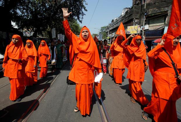 Hindu nuns shout slogans during a rally to mark the International Women's Day in Kolkata
