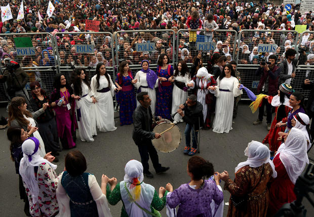 Participants dance during a rally on the International Women's Day in Diyarbakir