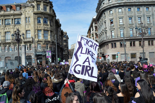 """A protester holds a banner reading """"Fight Like A Girl"""" during a demonstration for women's rights on International Women's Day in Bilbao"""