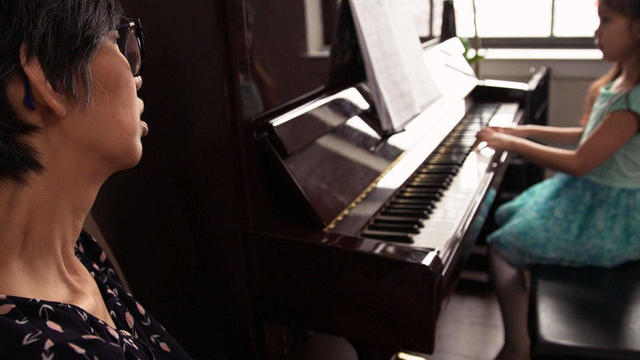 julia-yip-williams-with-daughter-playing-piano-promo.jpg