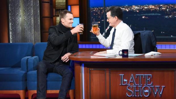 Beer chug: Tom Brady beats Stephen Colbert in seconds flat