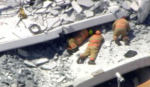 Witnesses describe hearing victims trapped in Miami bridge collapse