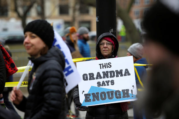 """Noreen Haiduk holds a sign as she attends the """"March for Our Lives"""" event after recent school shootings, at a rally in Chicago"""