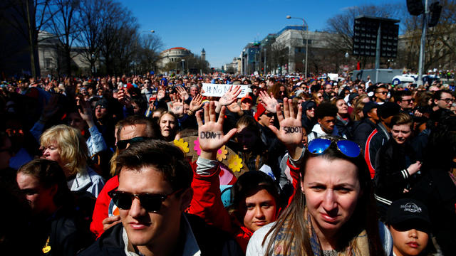 """Attendees are seen as students and gun control advocates hold the """"March for Our Lives"""" event demanding gun control after recent school shootings at a rally in Washington"""