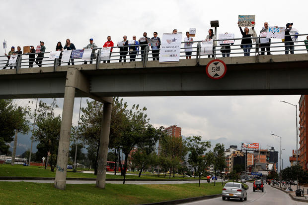 """People take part in the """"March for Our Lives"""", an organized demonstration to end gun violence in the United States, outside the U.S. embassy in Bogota"""
