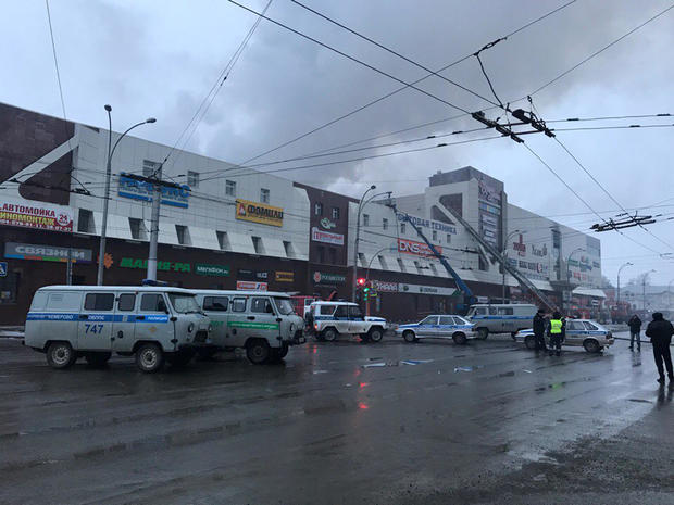 Rescue personnel is seen on a site of fire at a shopping mall in Kemerovo