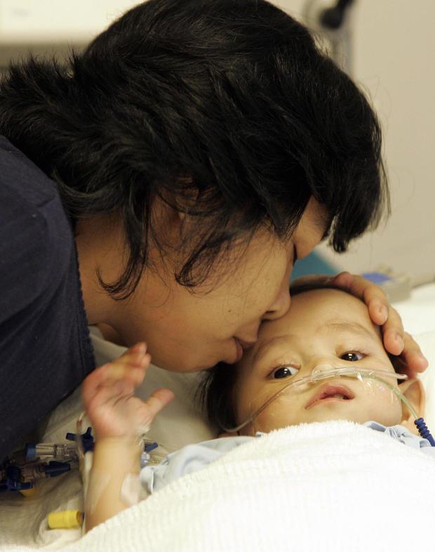 Indonesian mother, Neng Harmaini kisses