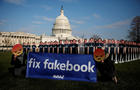 Dozens of cardboard cutouts of Facebook CEO Mark Zuckerberg are seen during an Avaaz.org protest outside the U.S. Capitol in Washington