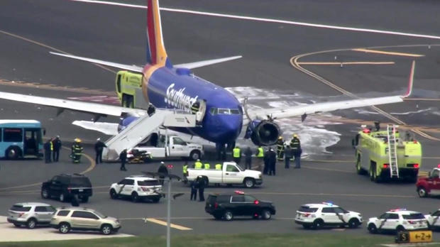 Crews work the scene after Southwest Airlines Flight 1380 made an emergency landing at Philadelphia International Airport on April 17, 2018.