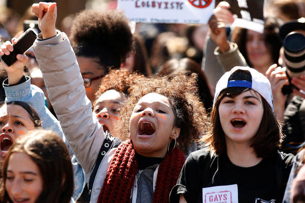 Youths take part in a national school walkout anti-gun march in Washington Square Park in the Manhattan borough of New York City April 20, 2018.