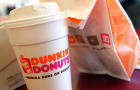 A cup of Dunkin' Donuts coffee and a doughnut bag sit on a counter Sept. 7, 2006, in Chicago, Illinois.