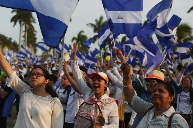 People take part in a protest march to demand an end to violence in Managua
