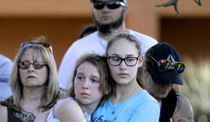 Family, friends hold vigils for Santa Fe school shooting victims