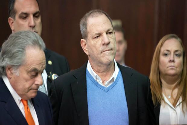Film producer Harvey Weinstein stands with his lawyer Benjamin Brafman, left, inside Manhattan Criminal Court during his arraignment in Manhattan in New York May 25, 2018.