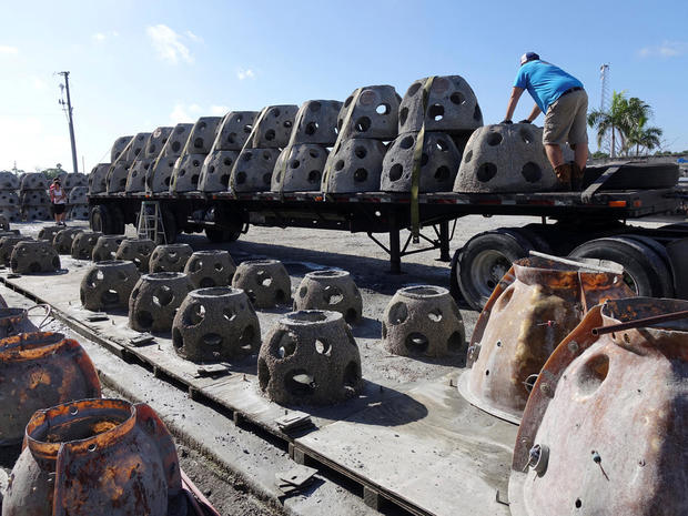 Workers unload some of the 66 Eternal Reef balls with plaques representing each of the submarines and crewmembers lost at sea since 1900, in Sarasota