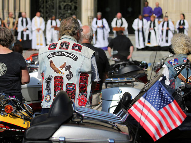 Rolling Thunder motorcyclists have their bikes blessed during a brief service at the National Cathedral in Washington