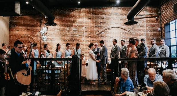 A bride and groom hold hands after floodwaters disrupted their wedding in Ellicott City, Maryland, on May 27, 2018.