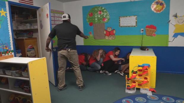 Teachers in Arizona take part in active shooter training/ CBS NEWS
