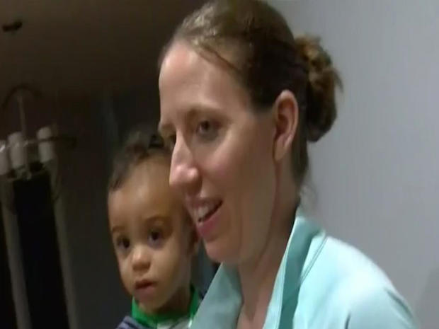 Lindsay Gottlieb, head coach of the University of California women's basketball team, holds her 1-year-old son during an interview with CBS San Francisco station KPIX-TV on May 28, 2018.