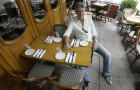 """Anthony Bourdain, host of the Travel Channel's """"No Reservations,"""" poses in a New York restaurant Aug. 8, 2007."""