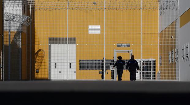 FILE PHOTO: Prison guards enter the Reau penitentiary