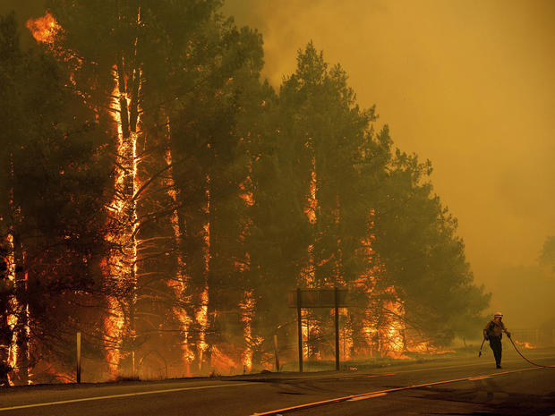 Wildfires scorch U.S., from East to West