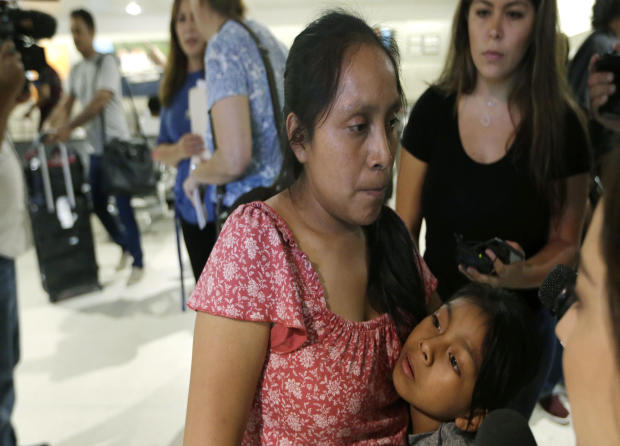 Buena Ventura Martin Godinez, left, hugs her daughter Janne after being reunited at Miami International Airport July 1, 2018, in Miami.
