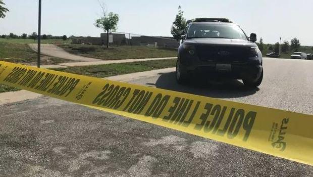 Police seek man in shooting of 2 workers at Kansas school