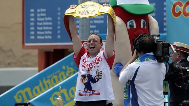 Joey Chestnut wins the annual Nathan's Famous hot dog eating contest, setting a new world record by eating 74 hot dogs in Brooklyn, New York, July 4, 2018.