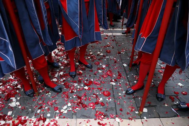 Petals thrown at a statue of Saint Fermin lie on the ground during a procession on the saint's day at the San Fermin festival in Pamplona