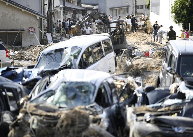 People clear debris caused by torrential rain at Aki ward in Hiroshima