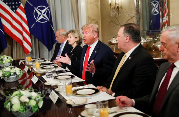 U.S. President Donald Trump gestures as he and U.S. Secretary of Defence James Mattis, U.S. Secretary of State Mike Pompeo attend a bilateral breakfast with NATO Secretary General Jens Stoltenberg ahead of the NATO Summit in Brussels