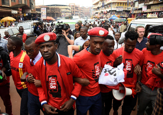 Ugandan musician turned politician, Robert Kyagulanyi, leads activists during a demonstration against new taxes including a levy on access to social media platforms in Kampala
