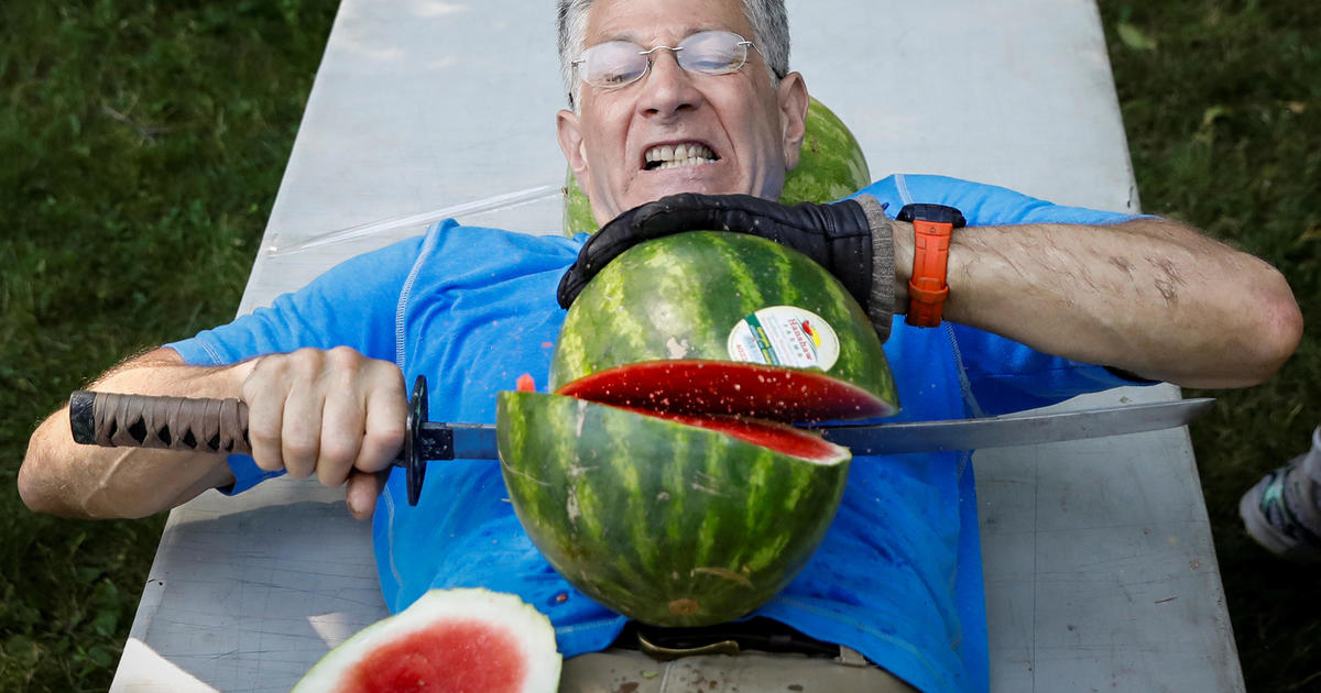 Man slices 27 watermelons in half on stomach, sets