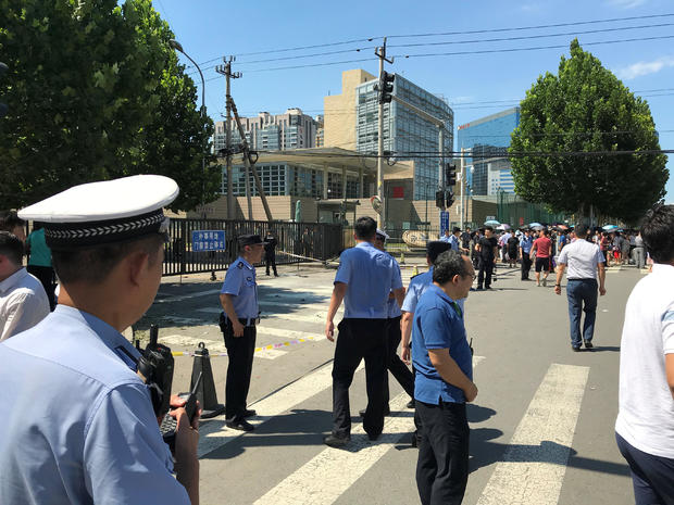 Police officers are seen standing guard near the U.S. embassy in Beijing,