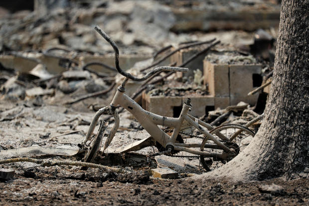A charred child's bike at a home that burned in the Carr Fire is seen west of Redding