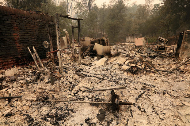 The debris of a burned home is seen after the Carr Fire west of Redding