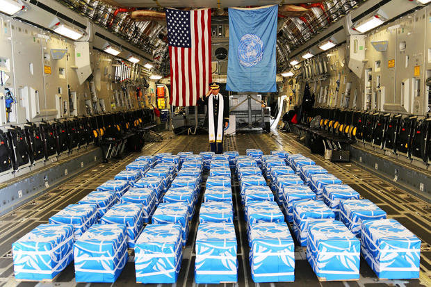 UN Command Chaplain U.S. Army Col. Lee performs a blessing on the 55 boxes of remains thought to be of U.S. soldiers killed in the 1950-53 Korean War at the Osan Air Base in South Korea