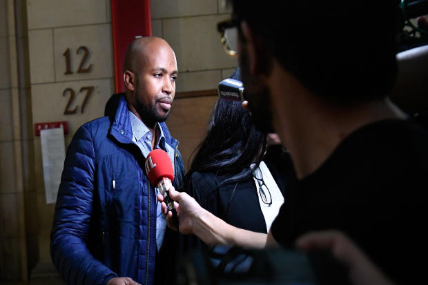 French rapper Rohff speaks to the media before his trial at a Paris courthouse on Sept. 29, 2017. The 39-year-old artist, whose real name is Housni Mkouboi, appeared before the Paris Criminal Court on a charge of aggravated violence stemming from an April 2014 incident in the Parisian shop of his rival, French rapper Booba.