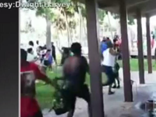 In this still from video posted on social media, people race for cover as a gunman opens fire Aug. 4, 2018, at a peace rally in Titusville, Florida.