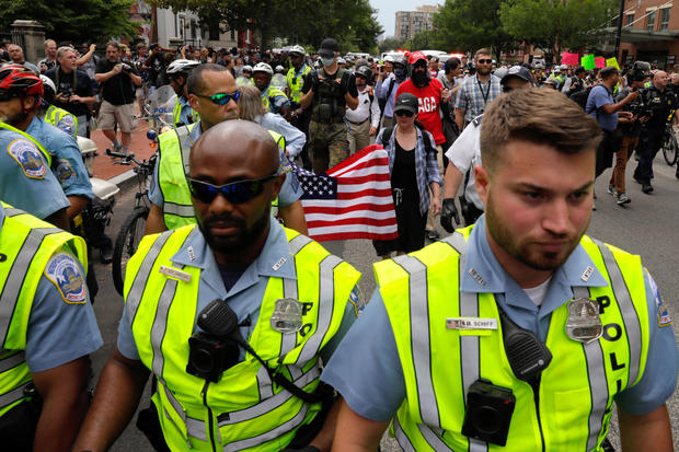 Police surround demonstrators participating at a white nationalist-led rally in Washington