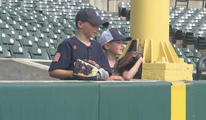 Boy shares foul ball with another young fan at Detroit Tigers game