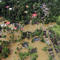 An aerial view shows partially submerged houses at a flooded area in the southern state of Kerala