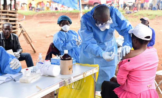 A Congolese health worker administers Ebola vaccine to a woman who had contact with an Ebola sufferer in the village of Mangina in the North Kivu province of the Democratic Republic of Congo Aug. 18, 2018.