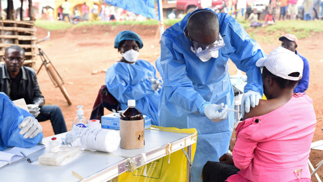 FILE PHOTO: A Congolese health worker administers Ebola vaccine to a woman who had contact with an Ebola sufferer in the village of Mangina