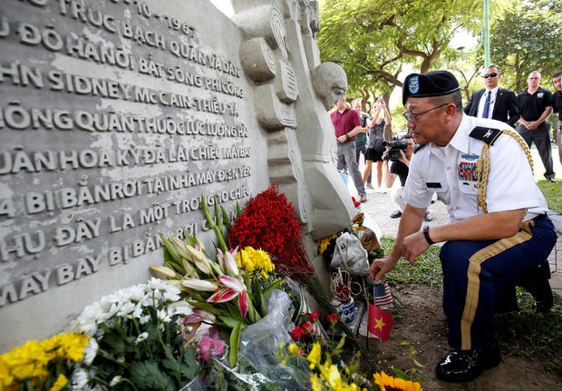 Military Attache Ton Tuan from U.S. Embassy places incense while he pays respect in memory of the late U.S. Senator John McCain (R-AZ) at the McCain Memorial in Hanoi