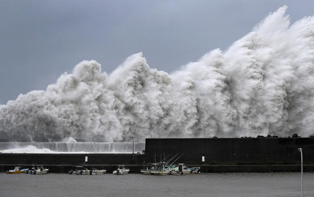 High waves triggered by Typhoon Jebi are seen at a fishing port in Aki