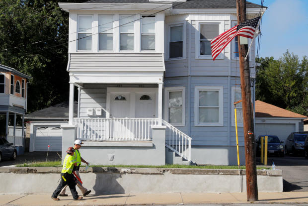 A Columbia Gas of Massachusetts crew works in a neighborhood evacuated following a series of gas explosions in Lawrence